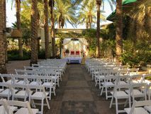 Colorful themed wedding stage and chairs.Hindu Traditional Wedding. In Asian tropical theme royalty free stock images