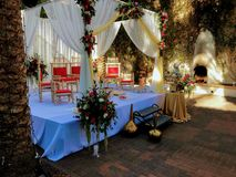 Colorful themed wedding stage and chairs.Hindu Traditional Wedding. In Asian tropical theme stock image