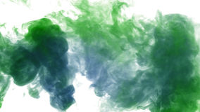 Colorful thick smoke on a white background isolated. Abstract art powder painted on white background. Movement abstract frozen dust explosion multicolored on royalty free stock photo
