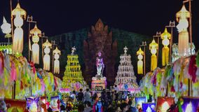 Colorful thousands lanna lanterns at night, Lamphun lantern festival. Up-Down. 4k, timelapse, The Phra Nang Chamthewi Statue, Lamphun, Thailand – 10 May stock footage