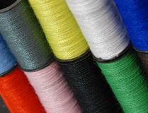 Colorful thread background. Several colors of stacked sewing threads - background Royalty Free Stock Photography