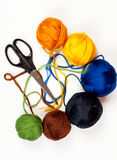 Colorful thread balls and scissors Royalty Free Stock Images