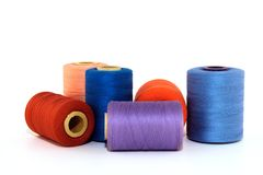 Colorful thread bobbins Stock Photo