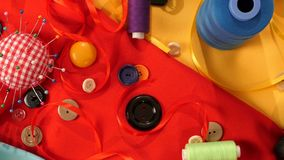 Colorful thread, buttons, pincushion, measuring stock footage