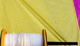 Colorful thread and a paper kite Royalty Free Stock Photo