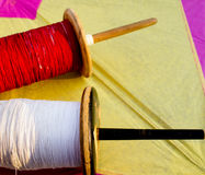 Colorful thread and a paper kite Stock Image