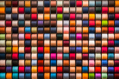 Colorful thread rolls background Royalty Free Stock Photos