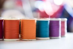Colorful thread shot with macro lens. Used threads for sewing cloths are shot to show colors and textures in natural light Stock Image