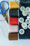 Colorful thread in spool, scissors and buttons Royalty Free Stock Photos