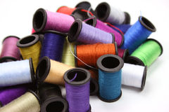 Colorful thread spools. Colorful cotton thread spools over white background Stock Images