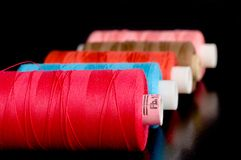 Colorful thread spools Stock Photo