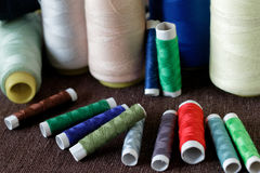 Colorful thread spools background. Colorful thread spools used in fabric and textile industry on a table Royalty Free Stock Image