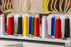 Colorful thread spools used in fabric and textile industry. The. Concept of sewing production Stock Images