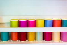Colorful thread spools used in fabric and textile industry with copy space stock image