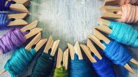 Business and education background. Colorful thread on wood workplace background, selective focus and vintage color tone process royalty free stock photo