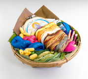 Colourful threads on the rattan basket  Royalty Free Stock Photo