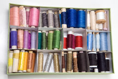 Colorful threads. Box full of colorful thread Stock Image