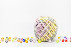 Colorful threads ball for knitting and beads on a white. Royalty Free Stock Image