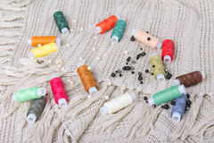 Colorful threads and beads on a fabric background Royalty Free Stock Photography
