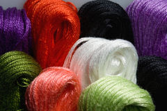 Colorful threads hanks. Macro shot of variegated threads set Stock Photography