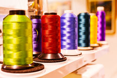 Colorful threads. Multicolored sewing threads on spool; note shallow depth of field Royalty Free Stock Photos