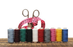Colorful threads and old scissors Royalty Free Stock Images