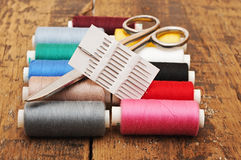 Colorful threads and old scissors Stock Image