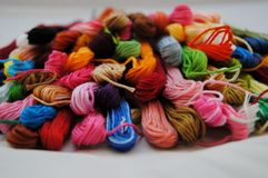 Colorful threads. A pile of colorful embroidery threads Royalty Free Stock Photo