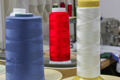 Colorful threads. Colorful reels of threads. Shallow depth of field Royalty Free Stock Photo