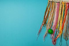 Colorful threads set for needlework stock images