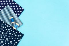 Blue polka dot fabric on blue background royalty free stock images