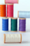 Colorful threads on the table Stock Photos