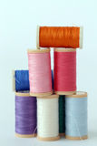 Colorful threads on the table Stock Photo