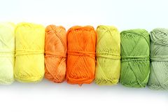 Colorful threads on the table Stock Images