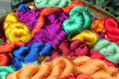 Colorful threads of Thai silk in a basket closeup for background. Royalty Free Stock Photos