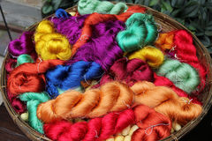 Colorful threads of Thai silk in a basket closeup for background. Stock Photo