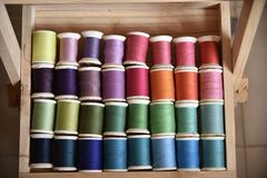 Colorful threads in wood box. Used colorful treads for sewing cloths are placed in wood box Stock Images