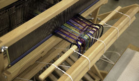 Colorful Threads on a Wooden Loom Stock Photo