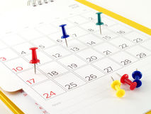 Colorful thumbtack on important day in calendar Stock Image