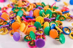 Colorful thumbtacks Stock Photos