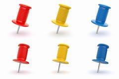Colorful thumbtacks on white  background Royalty Free Stock Image