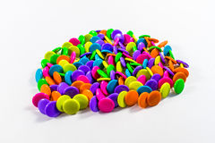 Colorful thumbtacks. On a white background Stock Images
