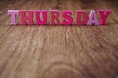 Thursday alphabet letter with space copy on wooden background. Colorful Thursday alphabet letter with space copy on wooden background royalty free stock photos