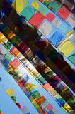 Colorful Tibetan Buddhism prayer flags lungta and sun in Svayambunatkh temple. Stock Photos