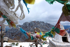 Colorful Tibetan flags with snow mountain Royalty Free Stock Photography