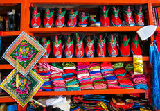 Colorful Tibetan shoes on display in shop Stock Photography
