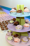 Colorful Tier of Cupcakes. Several k cupcakes arranged on a tiered tray Stock Images