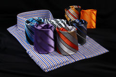 Colorful ties and dress shirt. On black  background Stock Images