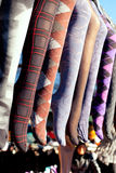 Colorful tights in a row hanging in market Royalty Free Stock Photography
