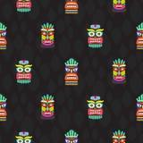 Colorful tiki masks totems seamless dark pattern vector. Stock Photo